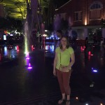 Beverly takes a step into the fountain at Clarke Quay.